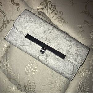 Silver and white clutch